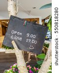 Wooden Sign And Time To Open...