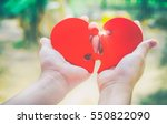 two hand holding connecting two ... | Shutterstock . vector #550822090