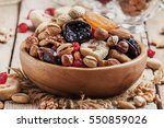 nuts and dried fruit mix ... | Shutterstock . vector #550859026