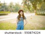 woman relaxing in park enjoying ... | Shutterstock . vector #550874224
