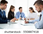 group of business people at a... | Shutterstock . vector #550887418