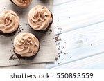 Tasty Cupcakes On A White...