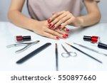 nail care. closeup of beautiful ... | Shutterstock . vector #550897660