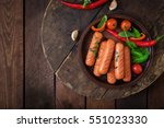 grilled sausages and vegetables ... | Shutterstock . vector #551023330