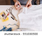seamstress unrips fabric near... | Shutterstock . vector #551030500
