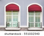 red awning over window balcony | Shutterstock . vector #551032540