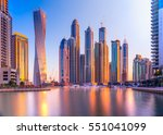 skyscrapers in dubai marina. uae | Shutterstock . vector #551041099