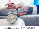 hand turns off the alarm clock... | Shutterstock . vector #551041420