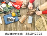 travel man tying boots for... | Shutterstock . vector #551042728
