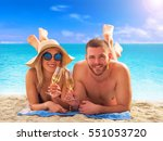 luxury beach couple vacation. | Shutterstock . vector #551053720