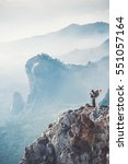 Small photo of Traveler backpacker on mountains cliff hiking enjoy landscape Travel Lifestyle concept adventure active vacations outdoor aerial view
