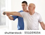physiotherapist working with... | Shutterstock . vector #551059054