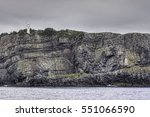 the lighthouse on the cliff at... | Shutterstock . vector #551066590