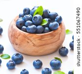 Small photo of Fresh blueberries in wooden bawl on white.