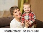 senior woman hold little baby... | Shutterstock . vector #551071630