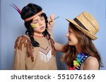 two children are dressing up... | Shutterstock . vector #551076169