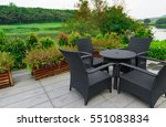 rattan sofa and table set in a... | Shutterstock . vector #551083834