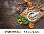 turmeric in mortar grinder... | Shutterstock . vector #551101228