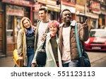 happy multiracial friends... | Shutterstock . vector #551123113