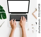 workspace with hands typing on... | Shutterstock . vector #551124958