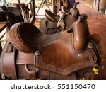 Two Brown Horse's Saddle On Th...