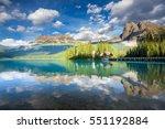 emerald lake in banff national... | Shutterstock . vector #551192884