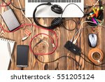 Untidy Working Desk With Various Cables In Office, Top View - stock photo