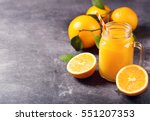 glass jar of fresh orange juice ... | Shutterstock . vector #551207353