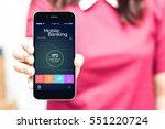 female hands hold mobile...   Shutterstock . vector #551220724