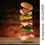 maxi hamburger with flying... | Shutterstock . vector #551235400
