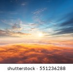 beautiful sunset above clouds... | Shutterstock . vector #551236288