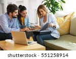Small photo of Real Estate agent offer home ownership and life insurance to young couple.