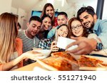Group Of Young Friends Eating...