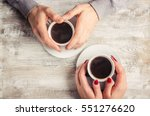 hot coffee in the hands of a... | Shutterstock . vector #551276620