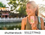 happy asian tourist woman... | Shutterstock . vector #551277943
