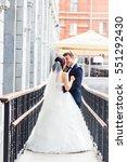 beautiful bride and groom... | Shutterstock . vector #551292430