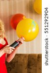 Small photo of Air pump and balloon indoors