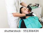 blue dental curing light is... | Shutterstock . vector #551306434