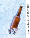cold bottle of beer on the ice... | Shutterstock . vector #551307100