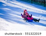 mother and daughter with sledge ... | Shutterstock . vector #551322019