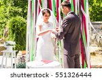 groom giving an engagement ring ... | Shutterstock . vector #551326444