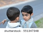 Small photo of Two Indian boys having an altercation.