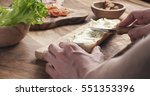 man spread cream cheese with...   Shutterstock . vector #551353396