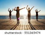 silhouettes of sportive girls... | Shutterstock . vector #551365474