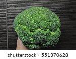 bright green broccoli on darken ... | Shutterstock . vector #551370628