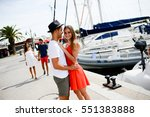 happy young couple walking by... | Shutterstock . vector #551383888
