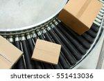 boxes on conveyor belt | Shutterstock . vector #551413036