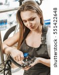 Small photo of Persevering craftswoman repairing the pedal in the garage