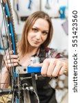 positive craftswoman fixing the ... | Shutterstock . vector #551423560