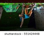 young woman bouldering in... | Shutterstock . vector #551424448